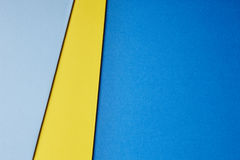 Colored cardboards background blue yellow tone. Copy space Royalty Free Stock Photo