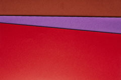 Colored cardboards background in red purple brown tone. Copy spa Stock Photos