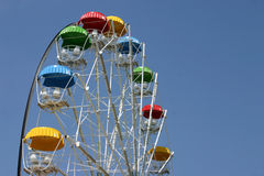Colored carousel circle viewing on a background of blue sky Royalty Free Stock Images