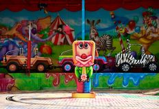 Colored carousel for the fun of children with cars. Colored carousel for the fun of children with caricatures of animals and funny situations stock photos
