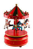 Colored carousel toy with horses close up, isolated, white background Royalty Free Stock Photo
