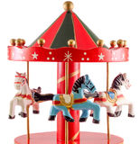 Colored carousel toy with horses, close up, isolated white background Royalty Free Stock Images