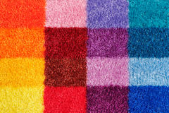 Colored carpet. Multi Colored carpet background divided on rectangules Stock Image