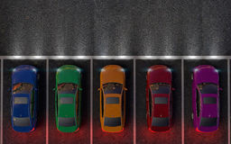 Colored cars are in the parking lot or getting ready for race. Royalty Free Stock Photos