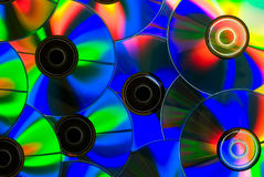 Colored CDs. There is colored CDs on black background Royalty Free Stock Images