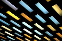Colored ceiling lamps on a black background royalty free stock images