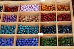 Colored ceramic beads. In a wooden box Stock Photo