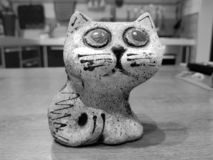 Colored ceramic cat with big eyes stock image