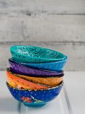 Colored ceramic dish on wooden table Stock Photo