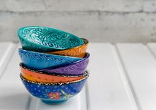 Colored ceramic dish on wooden table Royalty Free Stock Image
