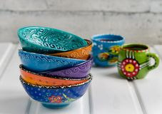 Colored ceramic dish on wooden table Stock Image