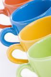 Colored ceramic mugs. In a line stock image