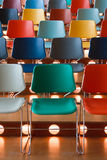 Colored chairs. Presentation hall with rows of colored chairs Royalty Free Stock Images