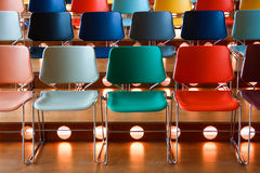 Colored chairs. Presentation hall with rows of colored chairs Royalty Free Stock Photo