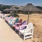Colored chairs. In the entrance of Morena Beach in Portugal Royalty Free Stock Photography