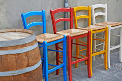 Colored chairs in street cafe Royalty Free Stock Photos