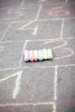 Colored chalk on asphalt Royalty Free Stock Photo