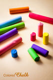 Colored chalk on a beige paper background Stock Photography