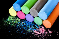 Colored chalk on a black background Stock Photos