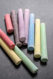 Colored chalk on a blackboard background Royalty Free Stock Photos