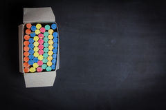 Colored chalk on a blackboard background Royalty Free Stock Photo