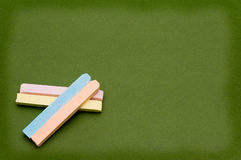 Colored chalk and board. Chalk over a green chalkboard Stock Photography