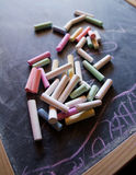 Colored chalk on the chalkboard. Colored chalk on the black chalkboard Stock Images