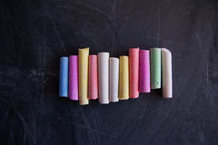 Colored chalk on the chalkboard. Colored chalk on the black chalkboard Stock Photography