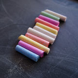 Colored chalk on the chalkboard. Colored chalk on the black chalkboard Royalty Free Stock Image