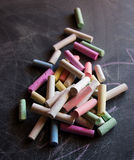 Colored chalk on the chalkboard. Colored chalk on the black chalkboard Stock Photo