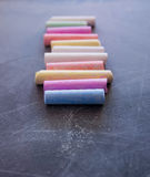 Colored chalk on the chalkboard. Colored chalk on the black chalkboard Stock Image