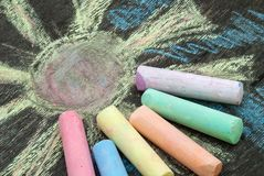 Colored chalk for drawing on a wooden background royalty free stock photo