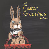 Colored chalk drawn illustration for Easter with rabbit in a wicker and golden text. Happy Easter theme. Card design. Royalty Free Stock Photo