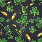 Colored chalk drawn seamless pattern for St. Patrick's Day with clover, golden coins and leprechaun hat. Stock Photos