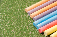 Colored chalk on green blackboard Stock Images