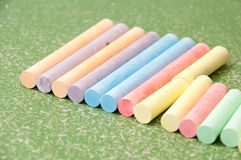 Colored chalk on green blackboard Stock Image