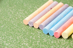 Colored chalk on green blackboard Royalty Free Stock Photos