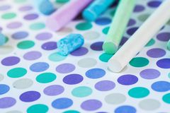 Colored chalk on the pastel background stock photo