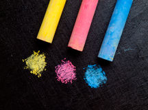 Colored chalk, primary colors. Colored chalk, primary colors , Yellow, red, blue , Drawing art in blackboard stock images