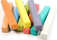 Colored chalk on white. Set of colored chalk on white royalty free stock photos