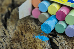 Colored chalk on wood Royalty Free Stock Photo