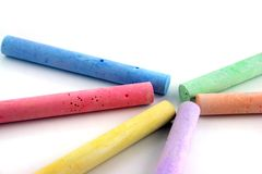 Colored chalks 1. Brightly colored chalks on a white reflective background Stock Photography