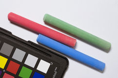 Colored chalks and color cheker Stock Photography