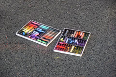 Colored chalks. Colored chalk on playground with drawings on street.  Stock Photos