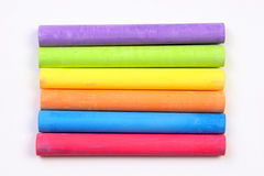 Colored chalks horizontal. Colored chalks over a white background Royalty Free Stock Photos