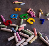 Colored chalks numbers and letters on blackboard Royalty Free Stock Images