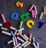 Colored chalks numbers and letters on blackboard Royalty Free Stock Photos