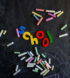 Colored chalks numbers and letters on blackboard Stock Image