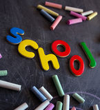Colored chalks numbers and letters on blackboard Stock Images