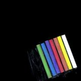 Colored chalks sticks. Pieces of colored chalks sticks over black background royalty free stock photo